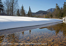 Swift River during the winter months in Albany, New Hampshire USA. This river travels along side of the Kancamagus Scenic Byway, which is one of New England's scenic byways. Mount Passaconaway is off in the distance