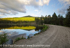 Reflection of Mount Deception in a small pond along Old Cherry Mountain Road in Carroll, New Hampshire USA during the spring months