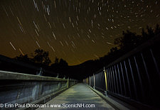 Star trails along the Kancamagus Scenic Byway (Route 112) in Lincoln, New Hampshire USA during the summer months