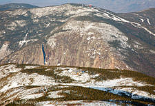 Cannon Mountain during the winter from Greenleaf Trail near the summit of Mount Lafayette in the White Mountains, New Hampshire USA. Greenleaf Hut is in the foreground