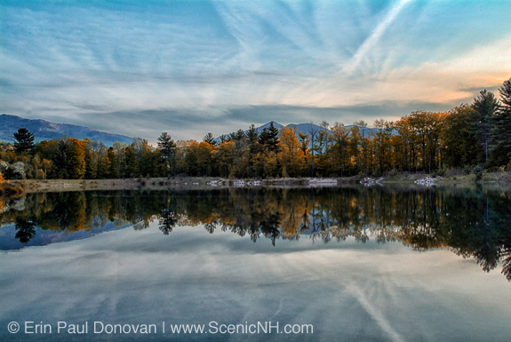Reflection of forest in Thorne Pond during the spring months. Located in Bartlett, New Hampshire in the White Mountains along Route 302.