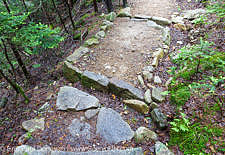 Open stone culvert (water bar) along the Mount Tecumseh Trail in Waterville Valley, New Hampshire USA