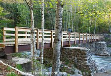 Abutments from Trestle 7 of the East Branch & Lincoln Logging Railroad are used to support the foot bridge along the Lincoln Woods Trail in New Hampshire.